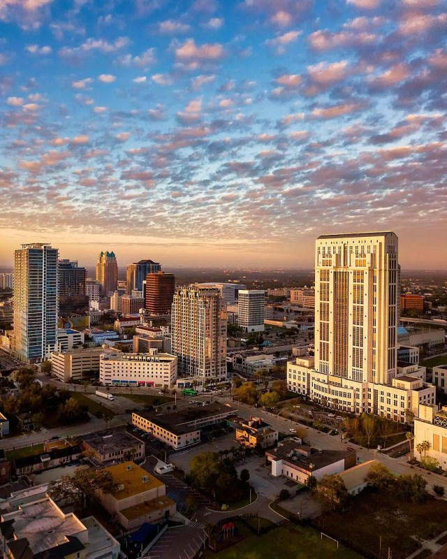 Tall buildings in Downtown Orlando at sunset. Photo by Instagram user @stevenmadow