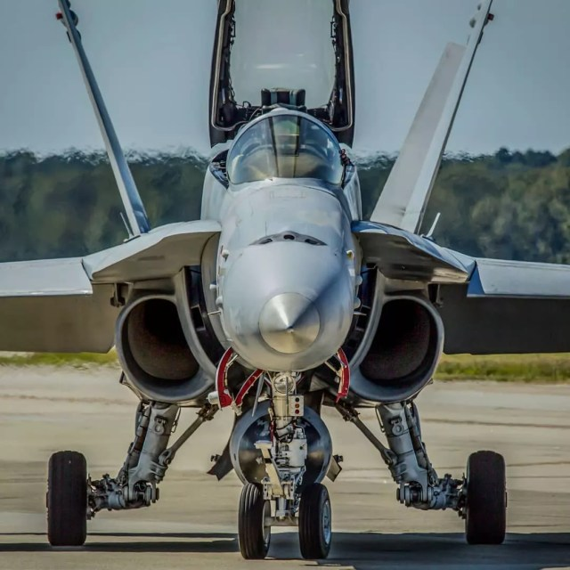 Silver fighter plane at Naval Air Station Oceana. Photo by Instagram user @deltawhiskeyphoto