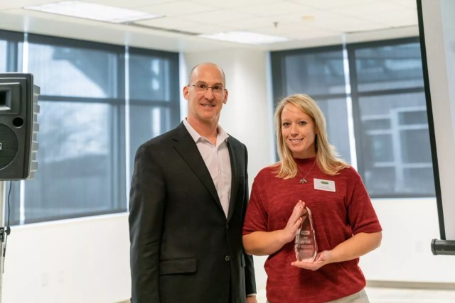 Christina Duffey, District Team Lead, poses with Joe Margolis, CEO of Extra Space Storage