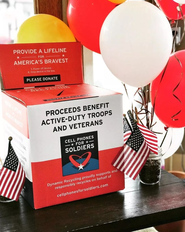 Red box by balloons for electric donations. Photo by Instagram user @amackswell