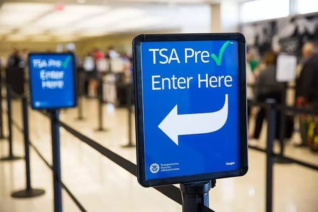 Blue TSA sign at the airport. Photo by Instagram user @flylansing