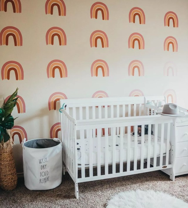 Nursery with rainbow wall. Photo by Instagram user @livin.mivida.ale