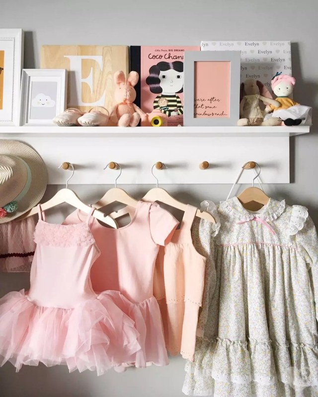 shelf with clothing hooks and clothes hanging photo by Instagram user @evelynloveshome