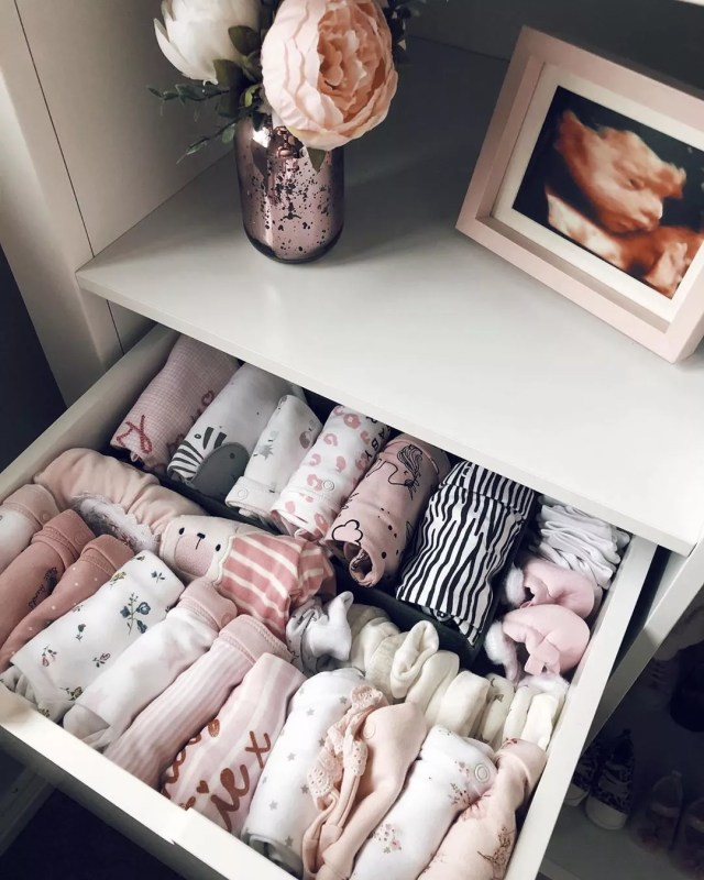 drawer filled with file folded baby clothes with sonogram image photo by Instagram user @hayitssamk
