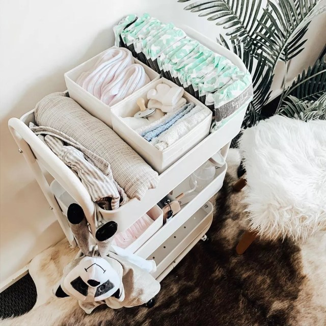 white diaper caddy with extra diapers and stuffed raccoon photo by Instagram user @__whiteathome