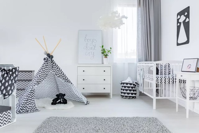 white baby nursery with small teepee and white crib