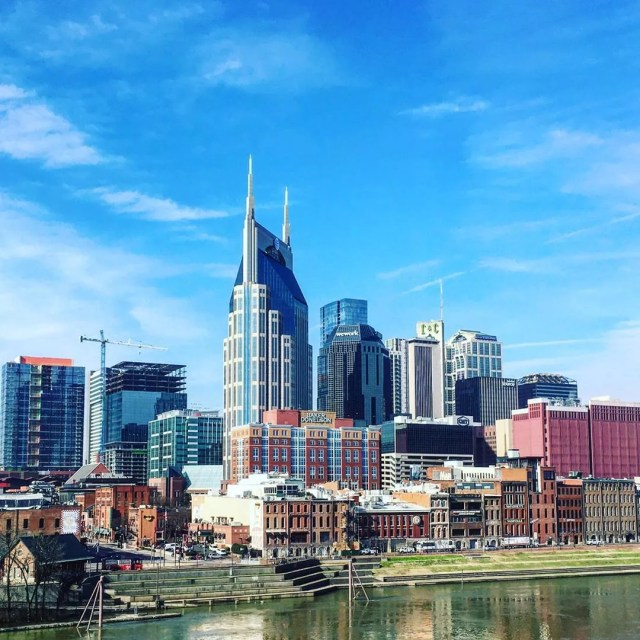 Nashville skyline with blue sky above photo by Instagram user @captainjoh