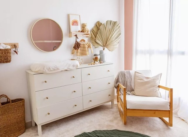 White dresser changing table in white nursery. Photo by Instagram user @denaemardon