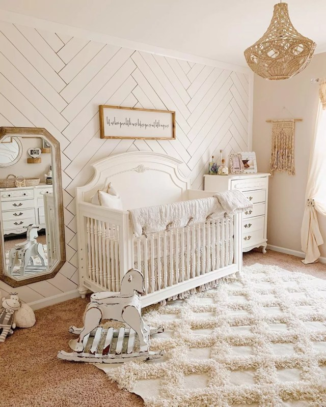 Neutral baby nursery with soft rug. Photo by Instagram user karlene_malcolm