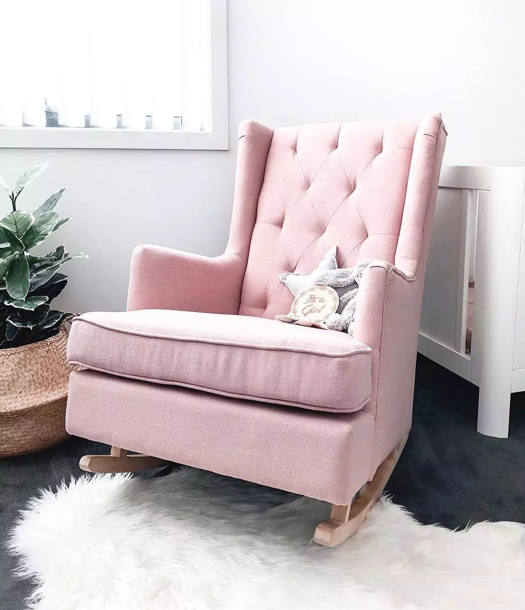 Pink rocking chair in nursery corner. Photo by Instagram user @mamaplusthree_