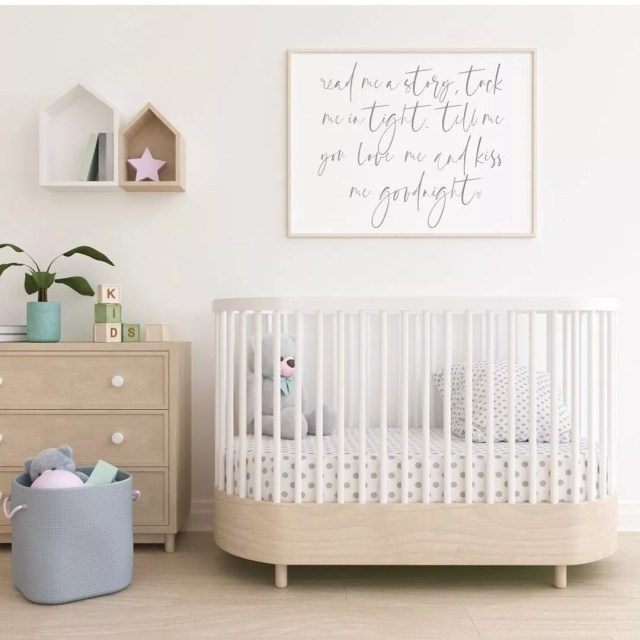 Simple white nursery with white crib. Photo by Instagram user @awdesigns_ca
