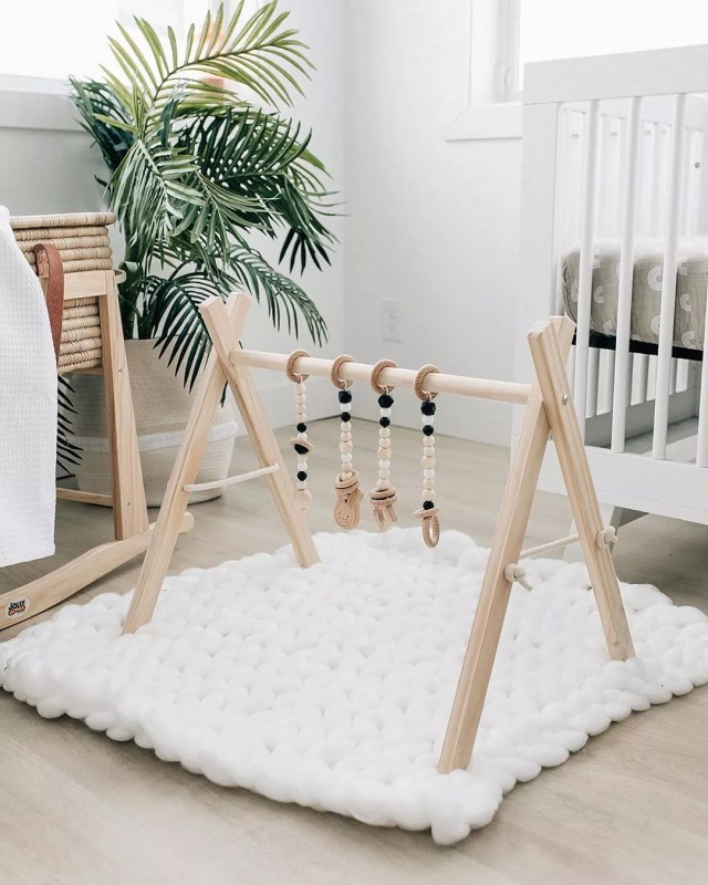 Plush baby mat under toy. Photo by Instagram user @poppyseed.play