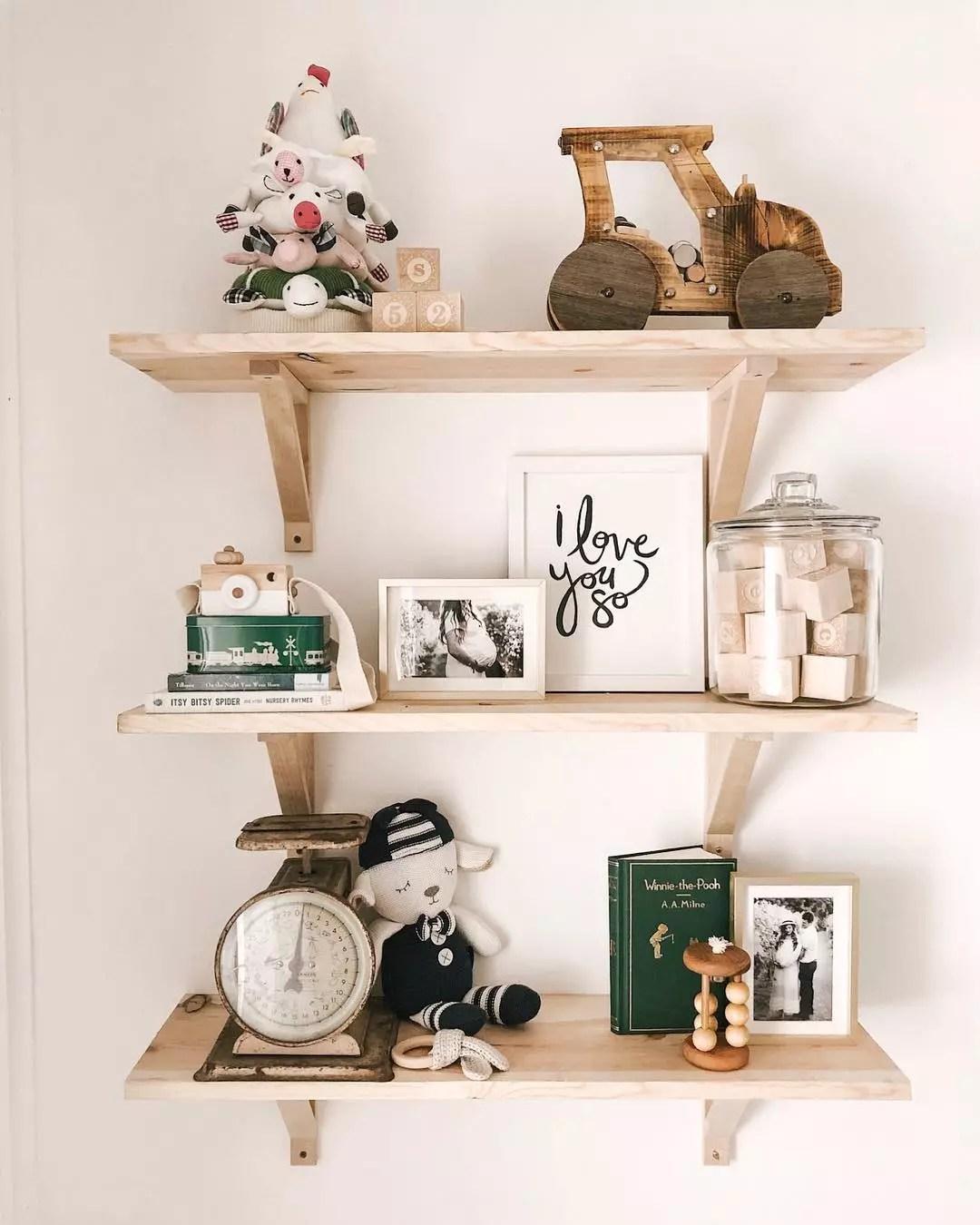 Floating shelves with baby decor. Photo by Instagram user @creativityinthecornbelt
