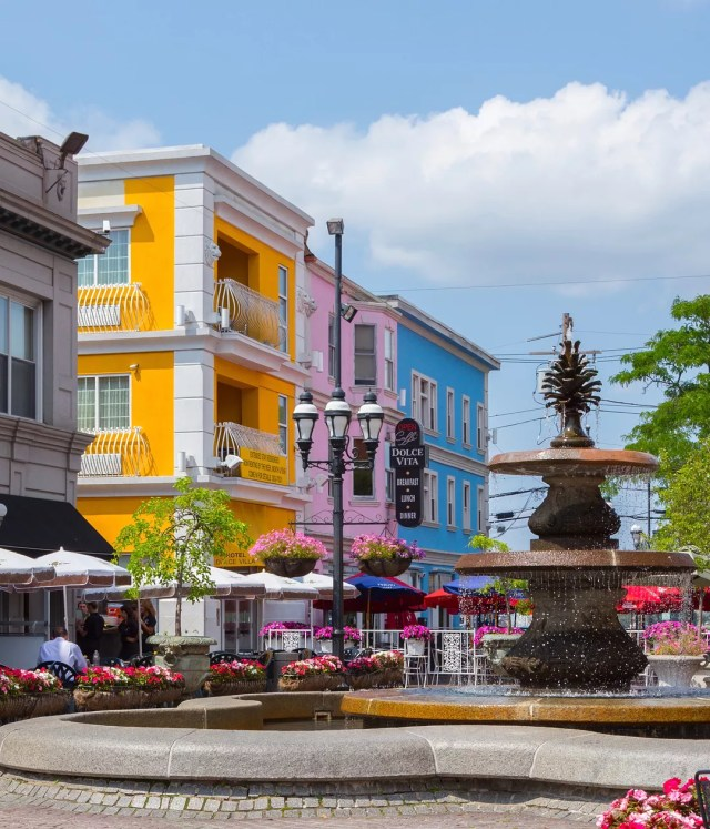 Federal Hill in Providence Little Italy with fountain and brightly painted buildings photo by Instagram user @federalhillri