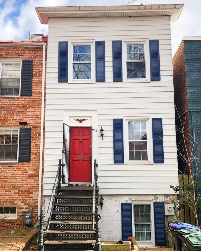 white Federal Style townhows with blue shutters and red door in Foggy Bottom, Washington, DC photo by Instagram user @penny.mause