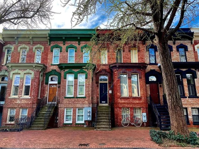 brick row houses with different color trim on each in Logan Circle, Washington, DC photo by Instagram user @sportyjordy15