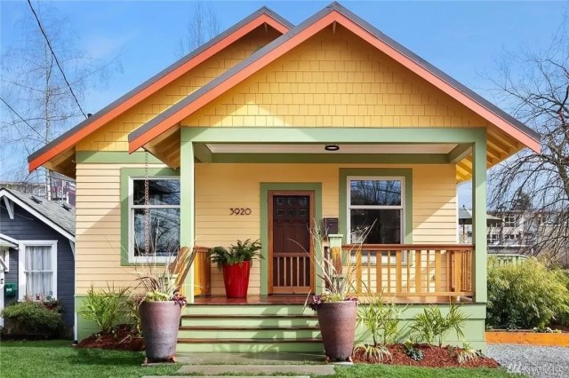 craftsman style home with yellow and green paint in Fremont, Seattle, WA photo by Instagram user @heidiwardrealestatebroker