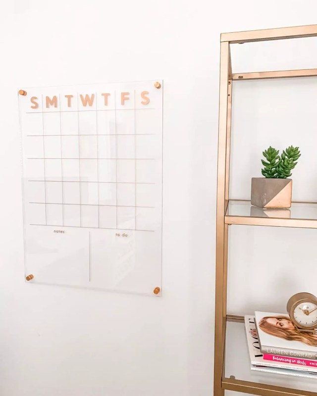 clear plexiglass wall planner with rose gold photo by Instagram user @mrsandsis