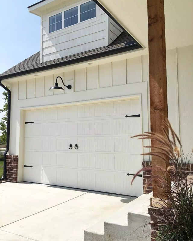 garage door with farmhouse style pieces added photo by Instagram user @concretecottage