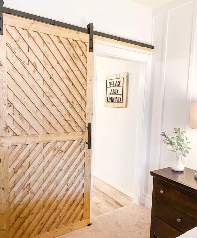 Sliding barn door set up in bedroom photo by Instagram user @ourtxnest