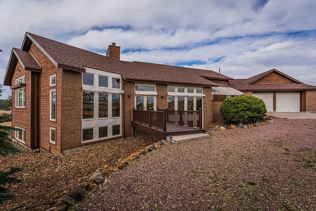 large brick home with xeriscaping in Northeast Colorado Springs photo by Instagram user @skylerkramervisuals