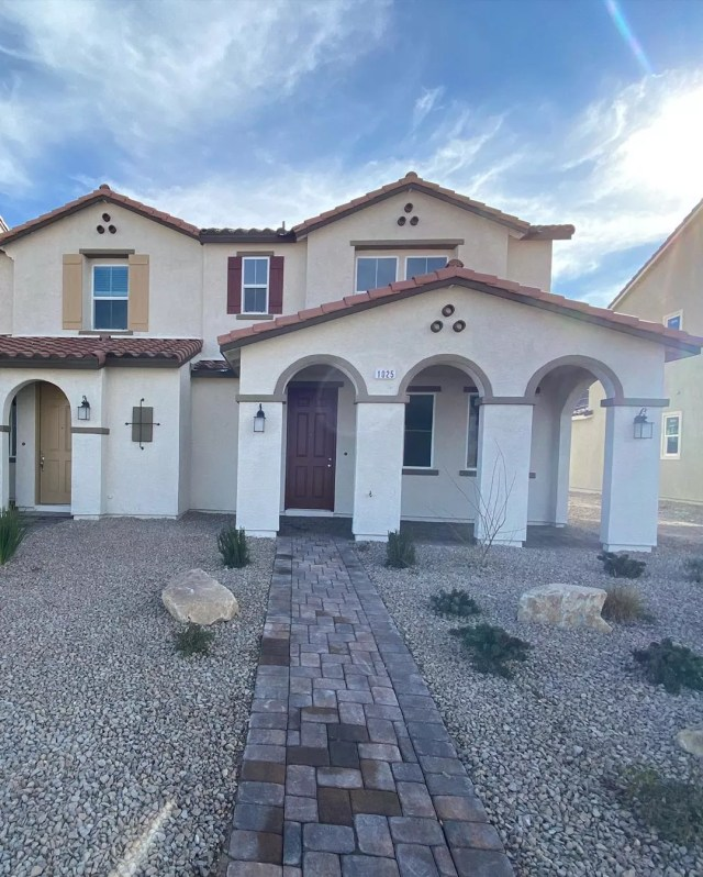 townhomes with Spanish style roof in Tule Springs, Las Vegas photo by Instagram user @kwsn_propertymanagement
