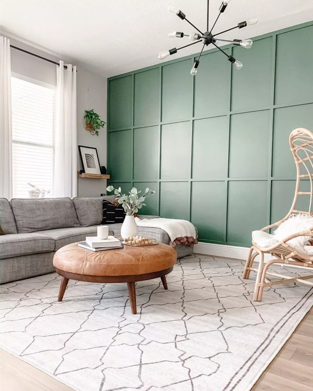 board and batten wall with green paint and modern furniture in the room photo by Instagram user @xomyhome