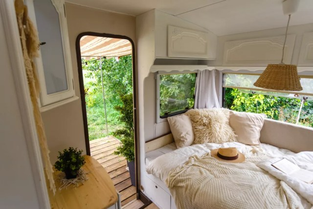 updated RV interior with comfy banquet seating near door