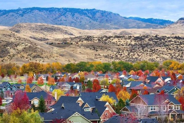 view of the hills in Boise behind the homes photo by Instagram user @relocationboiseidaho
