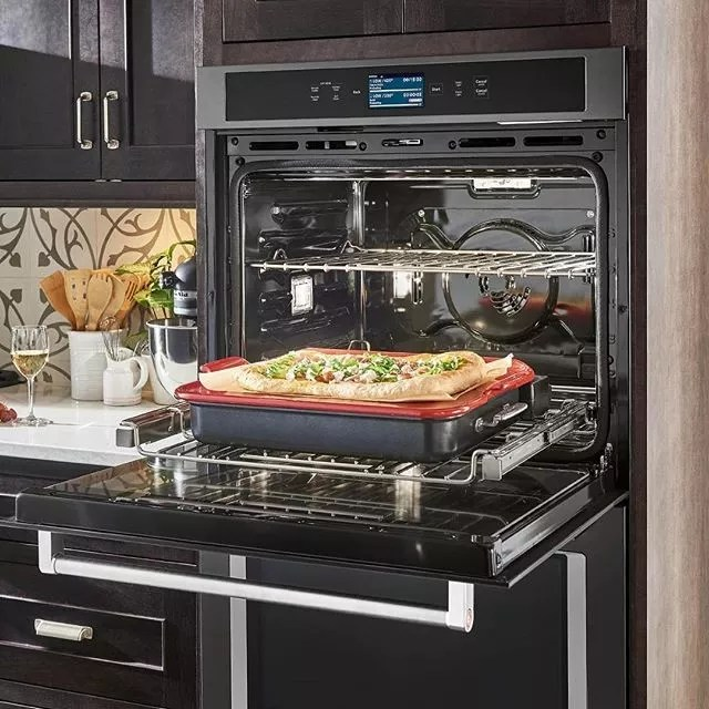 smart oven with pizza coming out of it photo by Instagram user @wilsonsappliances_mattresses