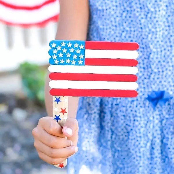 Child Holding American Flag Made of Popsicle Sticks. Photo by Instagram user @apumpkinandaprincess