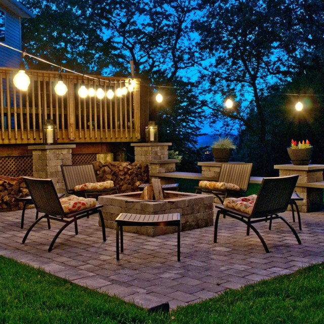 Outdoor Living Space with String Lights Hanging Above. Photo by Instagram user @lightsonline