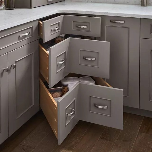 Oversized corner drawers in kitchen. Photo by Instagram user @designcraftcabinetry