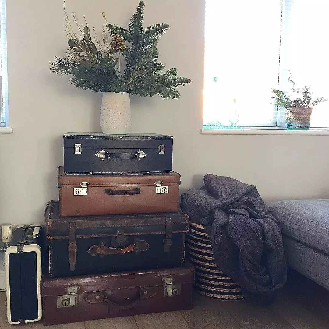 Vintage Suitcases Stacked and Used as an End Table. Photo by Instagram user @nest_number_9