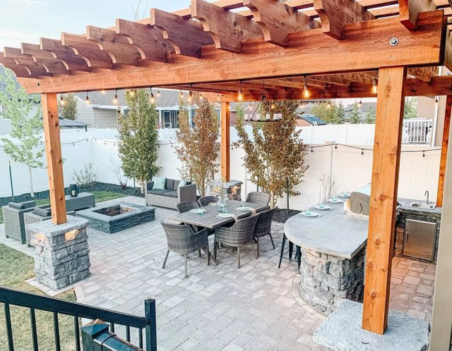 Backyard Living Space with Wooden Pergola. Photo by Instagram user @littlehouseintheprairies