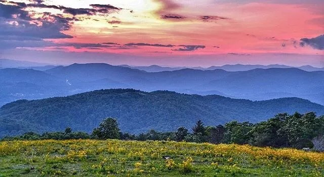 Sunset over Bearwallow Mountain in Asheville, NC. Photo by Instagram user @toddroy