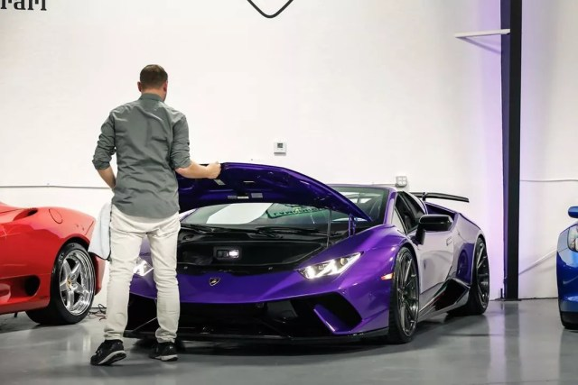 Man Closing the Boot of a Purple Lamborghini Huracan. Photo by Instagram user @wergs_automotive
