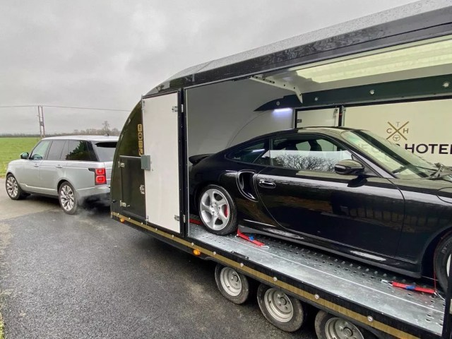 Black Porsche 996 Turbo Sitting In a Secure Car Trailer. Photo by Instagram user @the_car_hotel