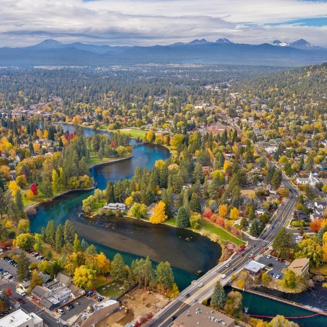 Aerial View of Bend, OR with Mountains in the Background. Photo by Instagram user @visitbend