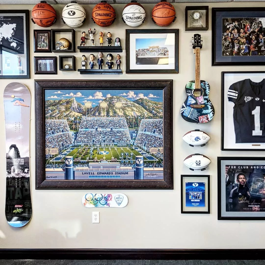 Wall with Lots of BYU Memorabilia. Photo by Instagram user @editdesignhouse
