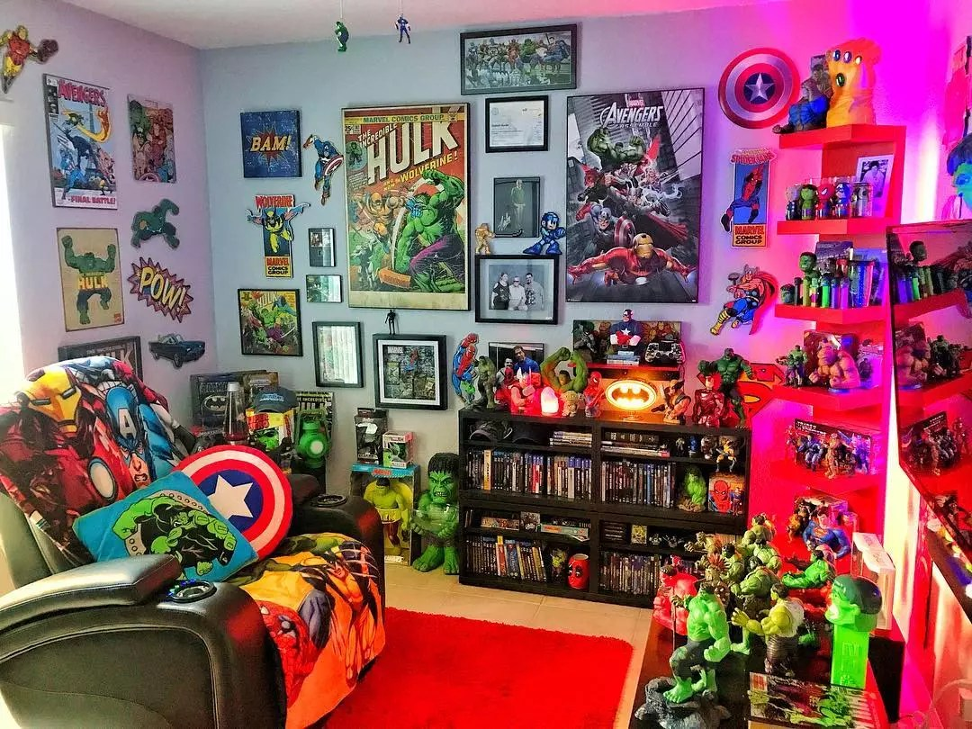 Man Cave with Lots of Comic Book Memorabilia On the Walls. Photo by Instagram user @josephburkearts