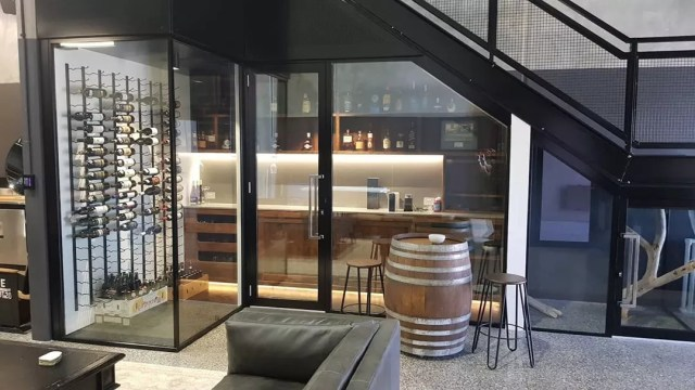 Under Stairs Wine Room with Glass Walls. Photo by Instagram user @caesarcellars