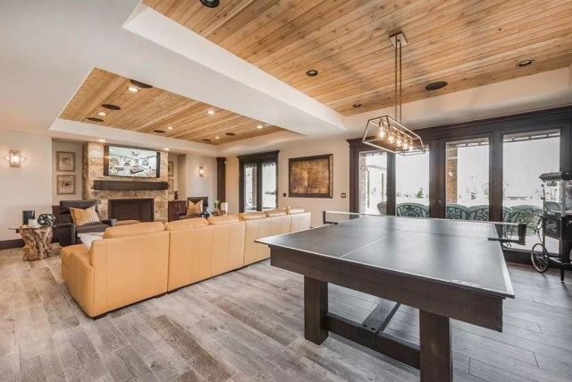 Beautifully Designed Finished Basement with Ping Pong Table and Wood Accents on the Ceiling. Photo by Instagram user @lanemyershomes