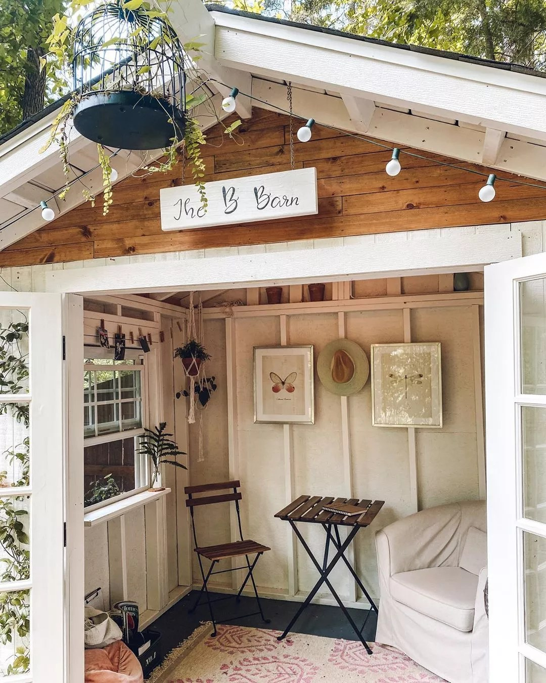 Small She Shed with a Soft Corner Chair and Sign Above the Door. Photo by Instagram user @theeverhopefulgardener
