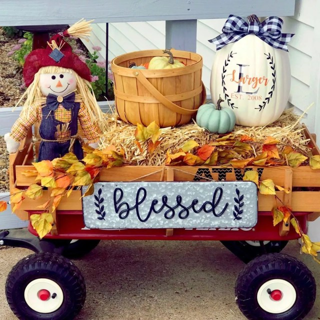 Small Red Rider Wagon Decorated in Fall Items. Photo by Instagram user @farmersburgburlapandbows