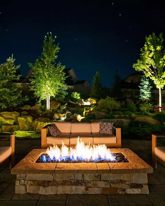 Backyard Fire Pit with Nice Furniture Around and Landscape Lighting. Photo by Instagram user @hineroutdoorliving