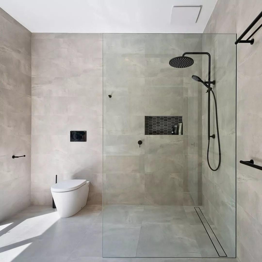 Gray modern tile shower with ventilation fan. Photo by Instagram user @fantechtrade