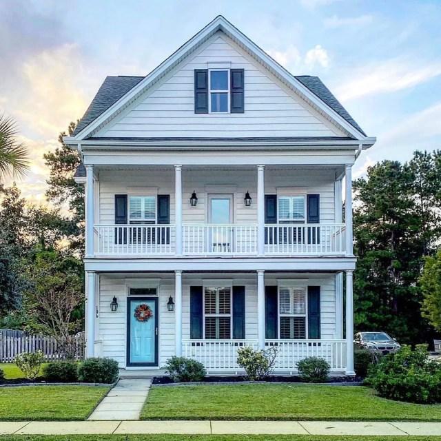 White multi-story home in Summerville, Charleston. Photo by Instagram user @mccrackenproperties