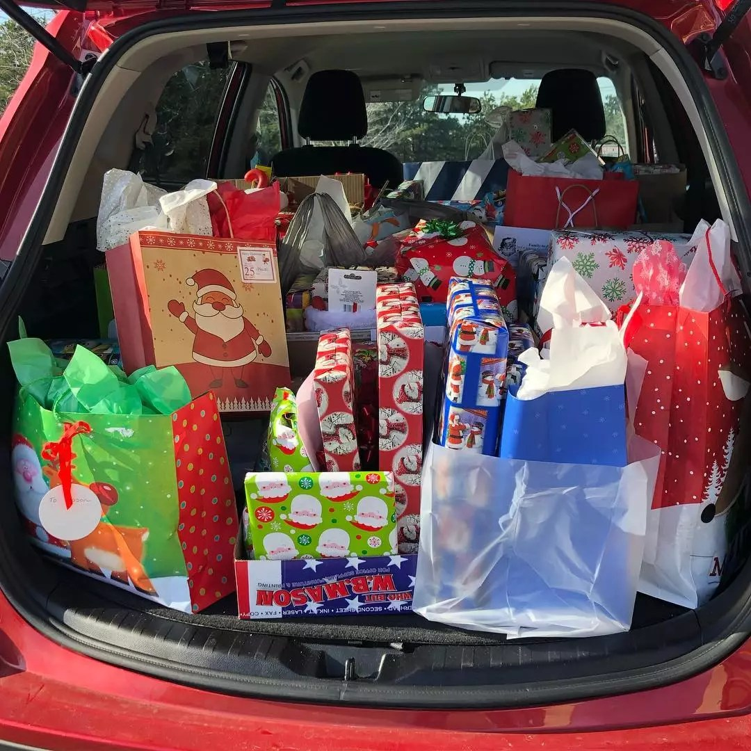 Lots of Wrapped Presents in the Back of a Car. Photo by Instagram user @the_adventures_of_saraht
