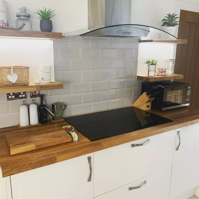 Updated Kitchen with Induction Cooktop on Wooden Counters. Photo by Instagram user @the_peacocks_and_the_pines